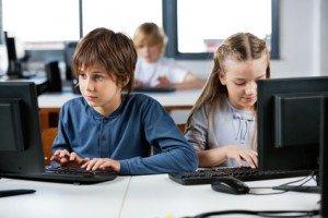 Schoolchildren Using Desktop Pc In Computer Lab