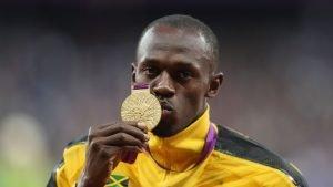 Dr. Michael Douglas adjusting Usain Bolt.